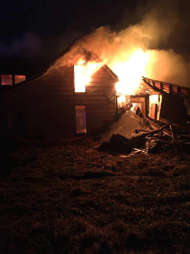 abandoned house on fire in Neosho