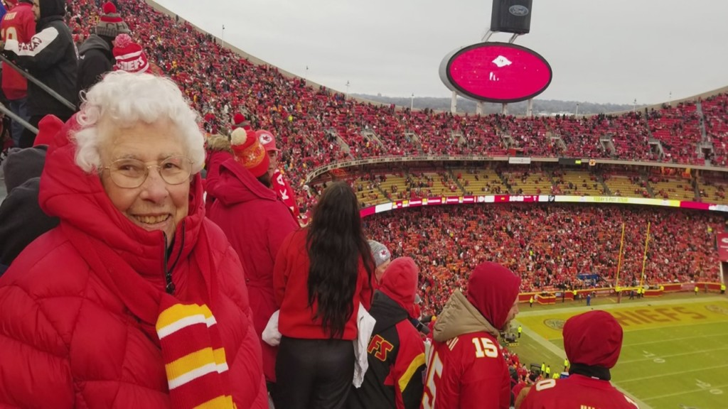 Helen Hubbard stands in the crowd at Arrowhead stadium