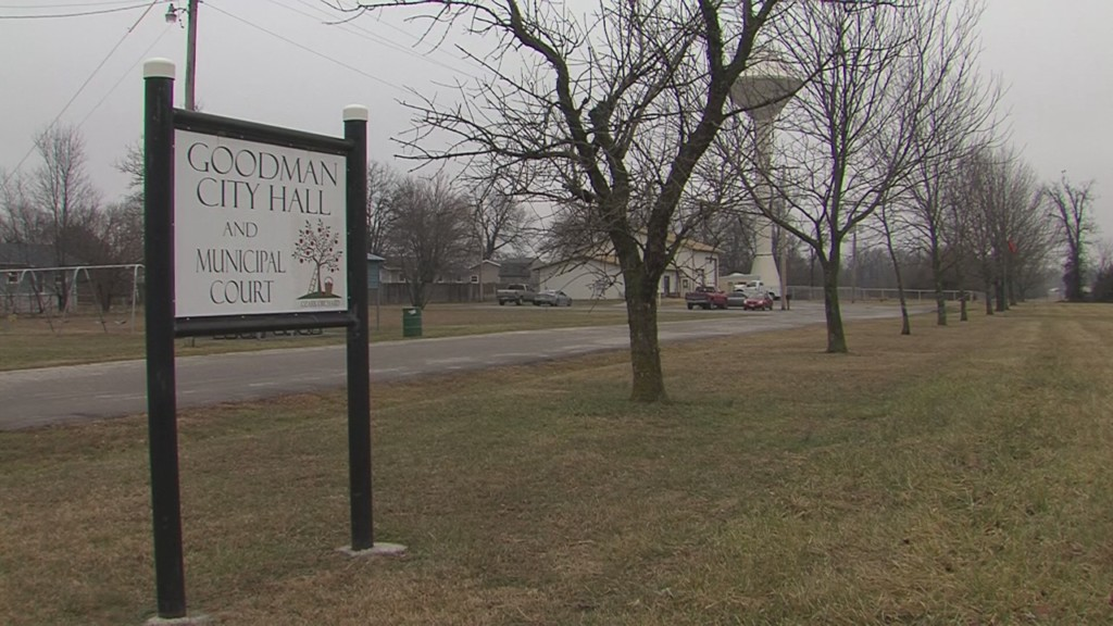 Goodman city hall sign in front of gravel road and city hall