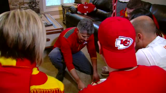 KOAM employees in Chiefs gear