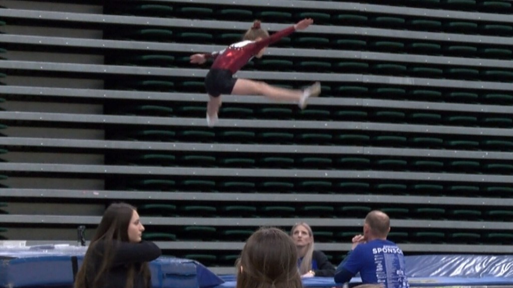 a competitor jumps on the trampoline