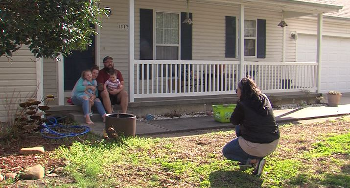 Darcie Silvers Taking A Photo Of The Haner Family During A Front Porch Photo Session