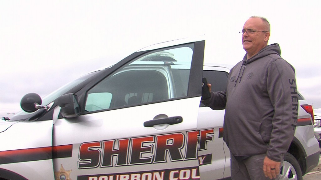 Sheriff Bill Martin Getting Ready To Get Into A Bourbon County Patrol Car