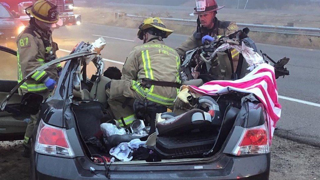 Driver survives after car crashes into semi, gets roof sheared off