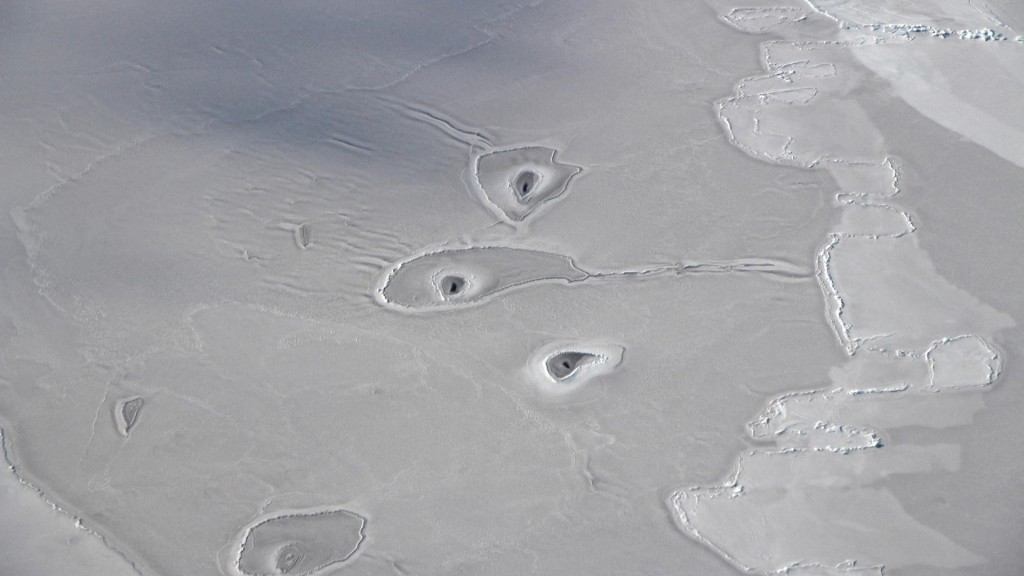 Hot summers causing arctic sinkholes as permafrost thaws rapidly