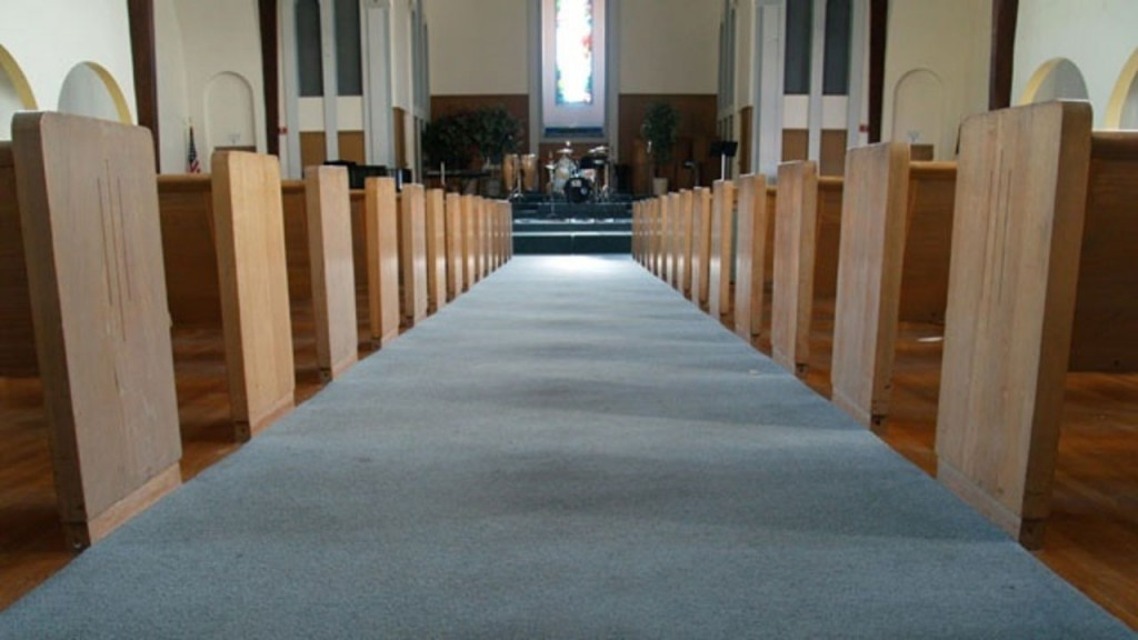 Inside of a church, showing center of seating row