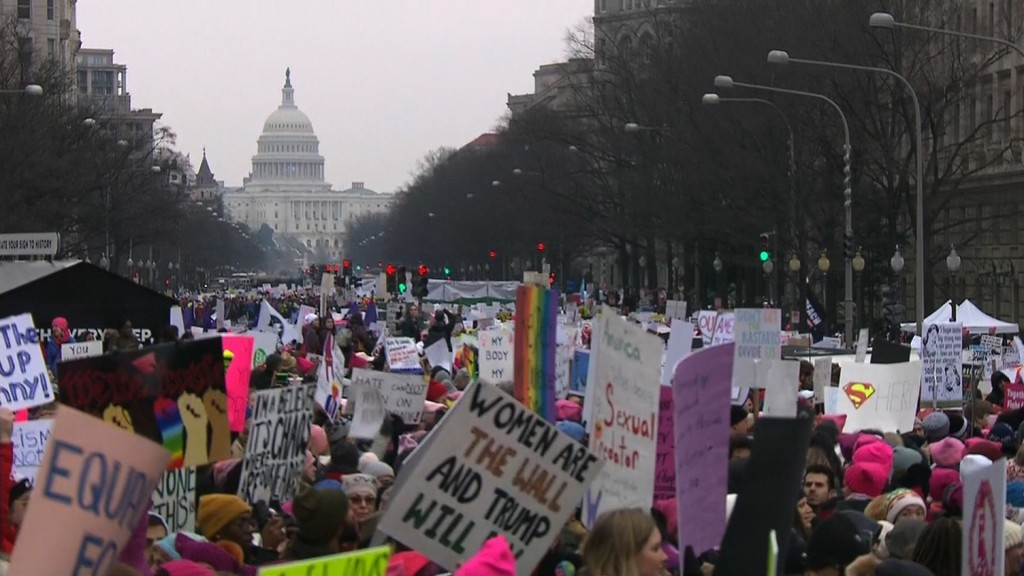 Women's marches vow 'to keep pushing' for change