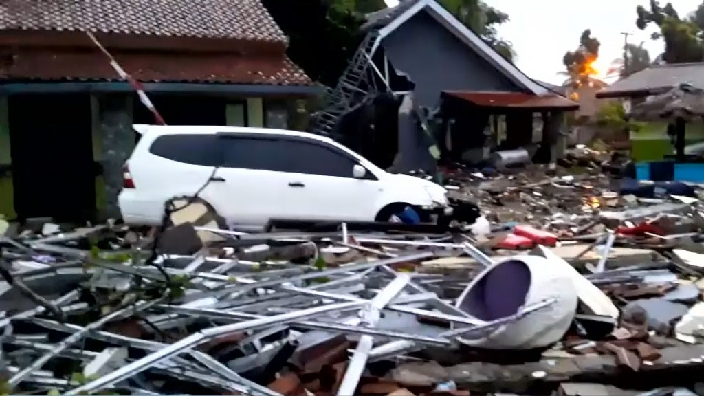 At least 168 killed when tsunami hits beaches in Indonesia