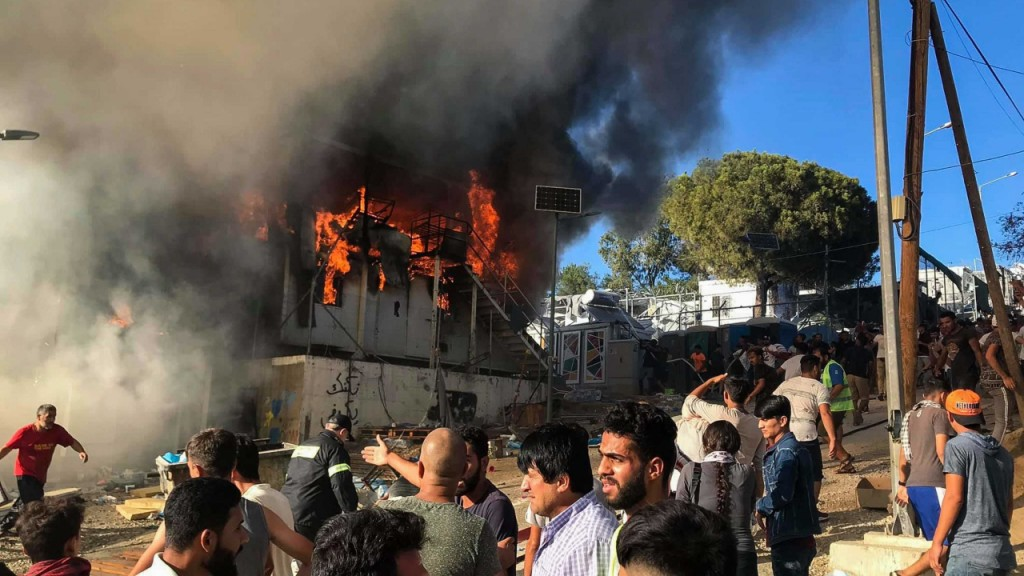 Fatal fire at packed refugee camp sparks riots among residents