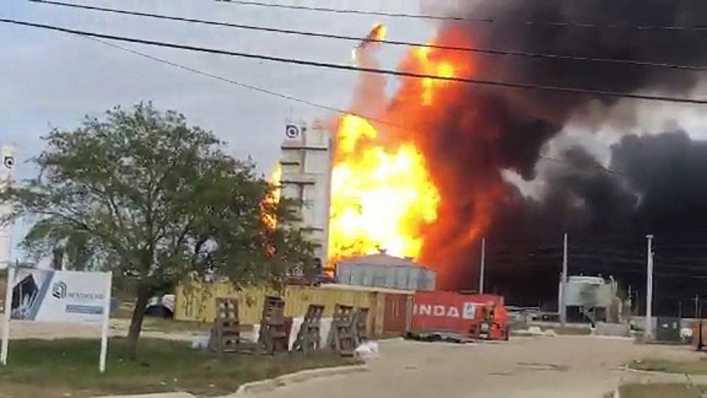 Thousands evacuate as chemical plant continues to burn