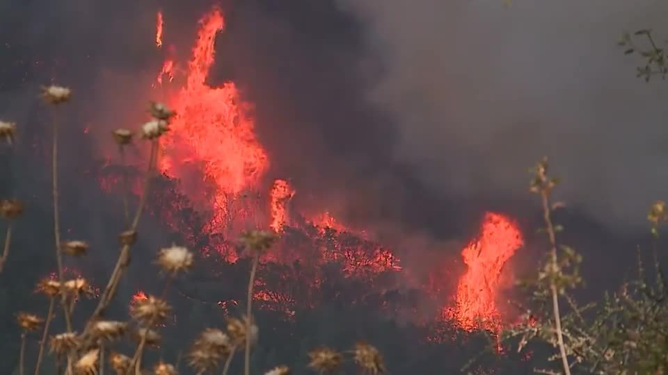 Rain will bring much-needed relief to California fires, but also new dangers