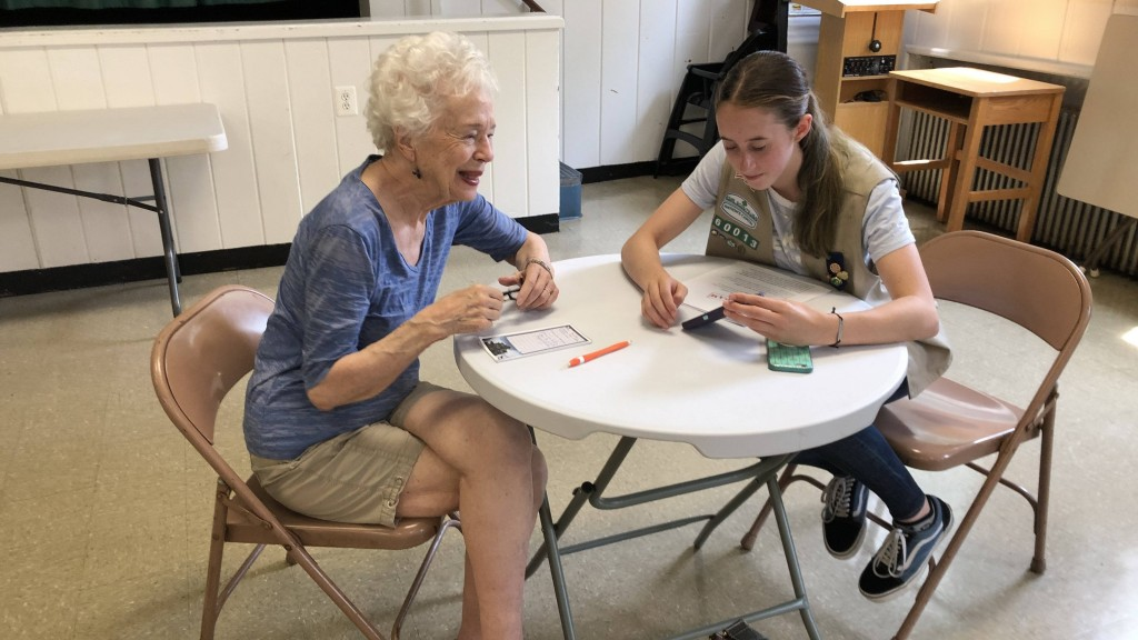 Girl Scouts teach seniors how to work smartphones