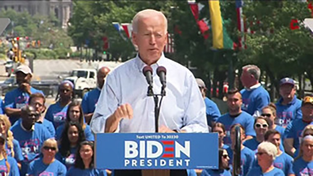 Biden calls for unity at first large rally