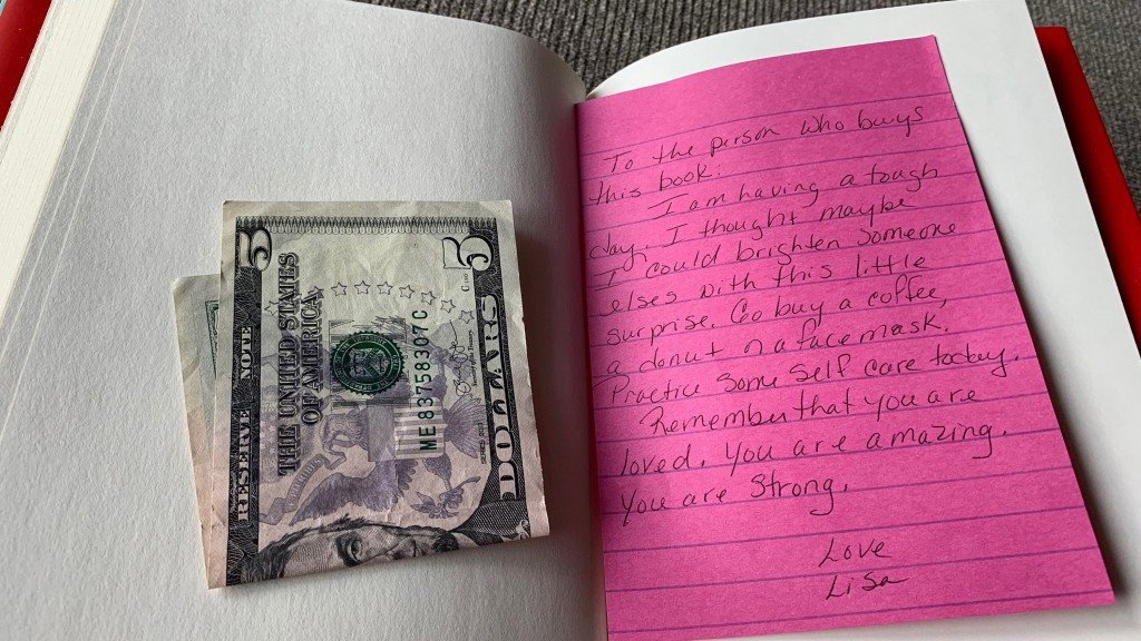 Gift in book sets off chain of random acts of kindness