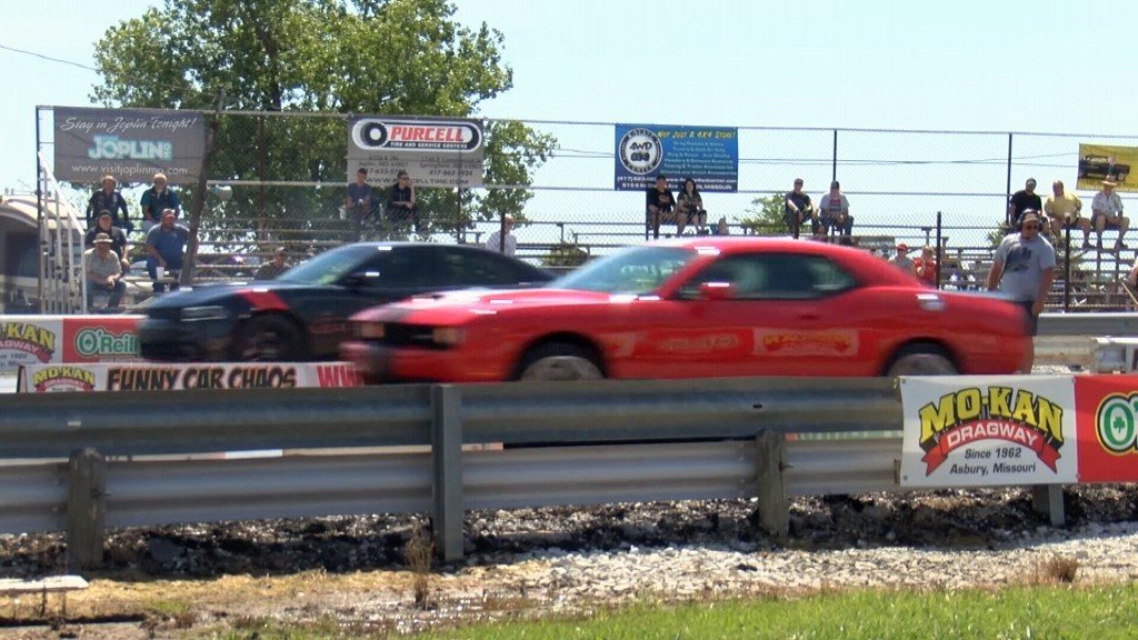 Cars Speed By At The Mo Kan Dragway