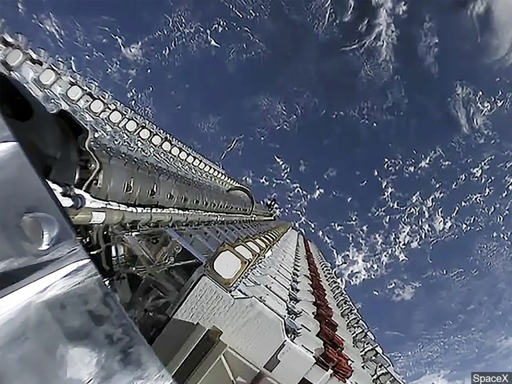 NASA astronauts conduct a spacewalk for space station power upgrades