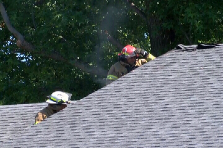 Firefighters Put Out An Attic Fire