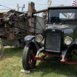Old Car Next To A Engine With A Belt System