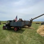 Old Combine With A Truck.