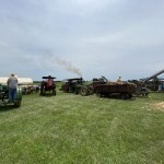 Wide Shots Of All The Tractors Working