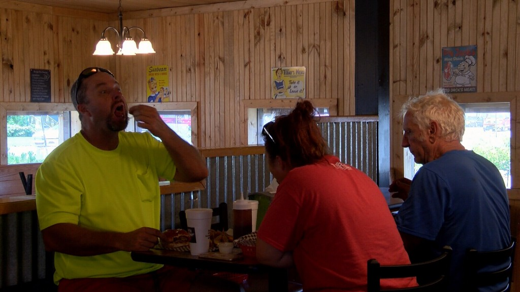 People Enjoy Lunch At Boomers Bbq
