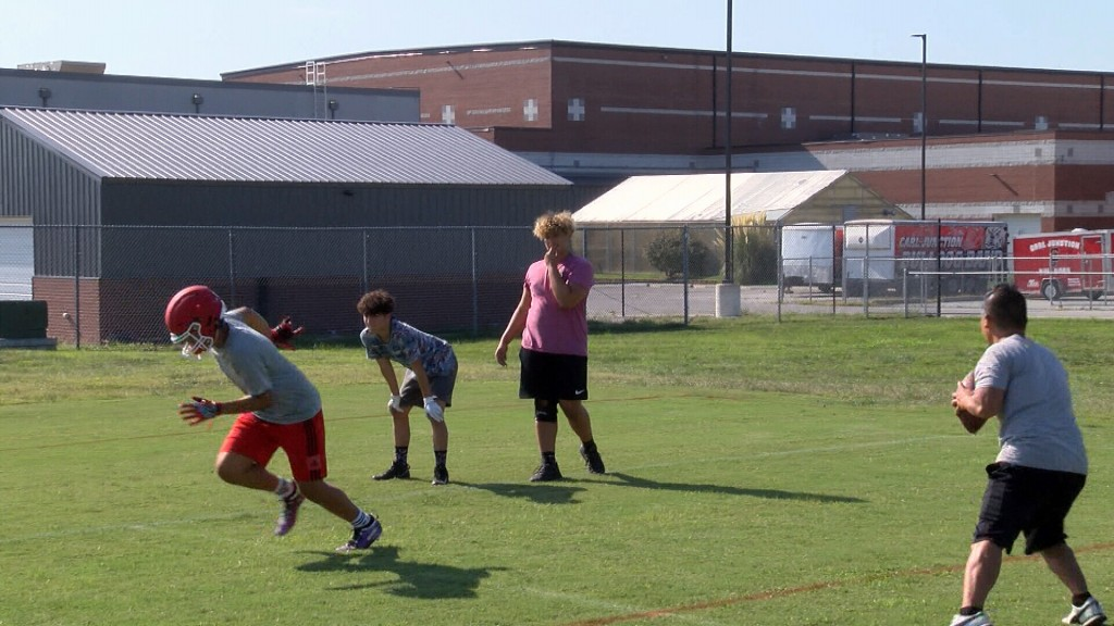 Cj Students Practice Football Before The Year Starts