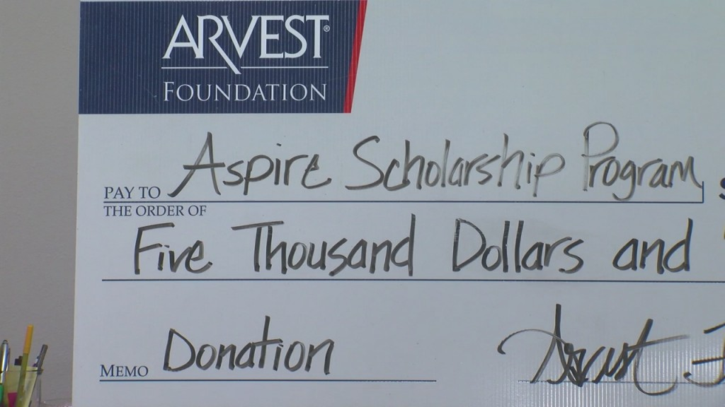 big check from arvest bank