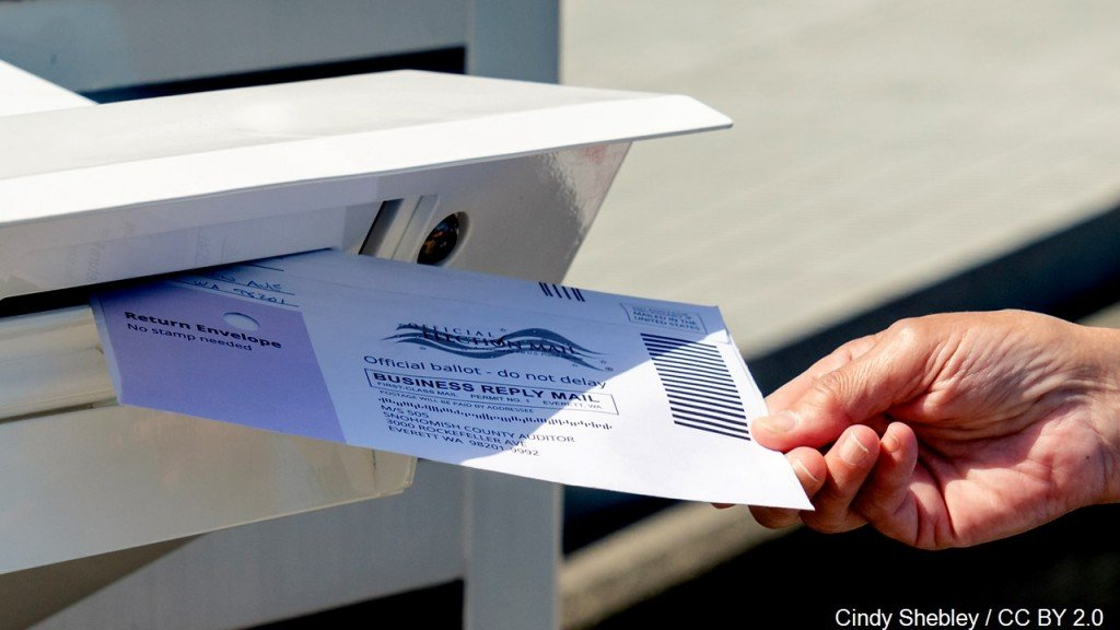 Dropping Mail In Ballot Into Mail Box, Mgn Image