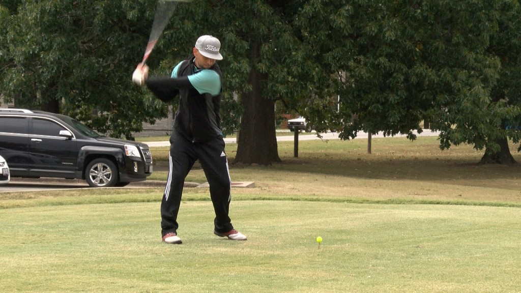 A Golfer Takes A Swing At The Wags Memorial Tournament