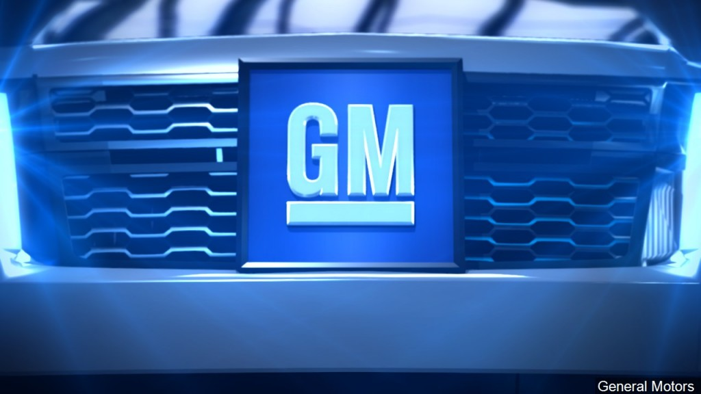 Gm Logo On Blue Vehicle Background