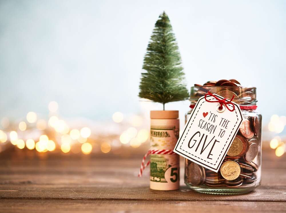 It's The Season To Give. Donation Jar With Money