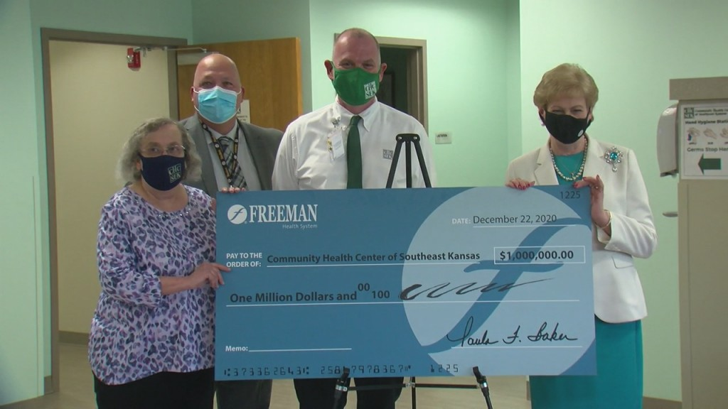 Freeman donating a check to the community health center of southeast kansas