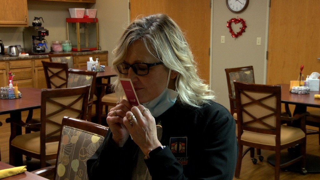 Nursing Home Employee Smells A Scratch And Sniff Covid Card