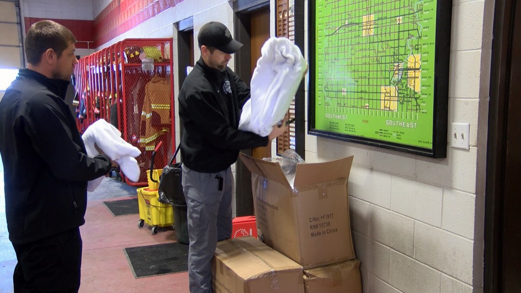 Columbus Fire Fighters Prep Blankets For Delivery