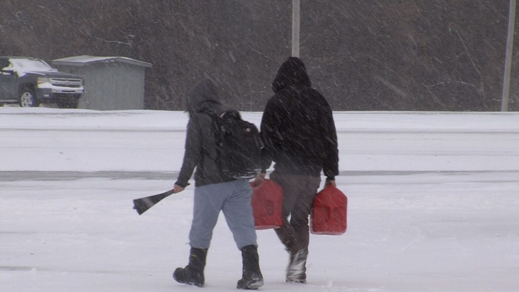 People Walking In Snow With Gas Containers Crawford County Kan Feb 15 2021