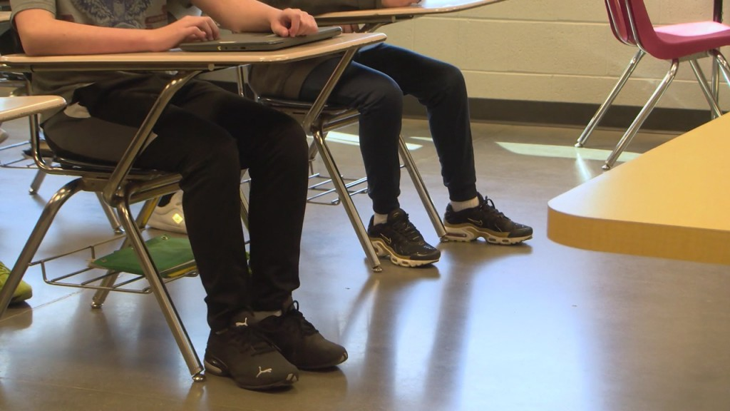 students sitting at desks in a classroom
