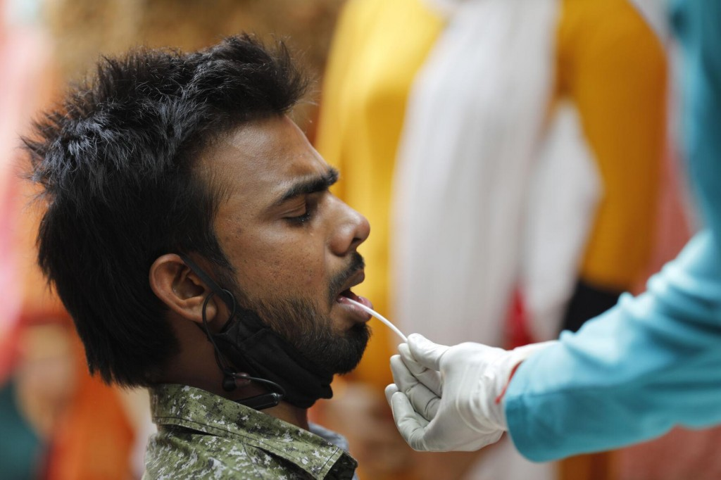 The Latest: Pakistan Lowers Age For Vaccinations