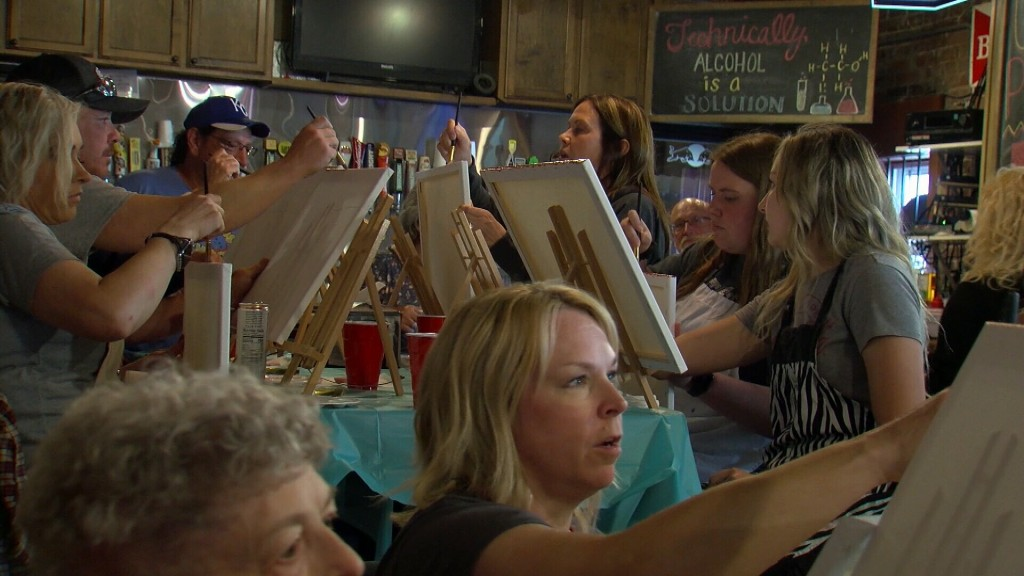 Folks Paint Pictures At A Fundraising Event For Neglected Donkeys