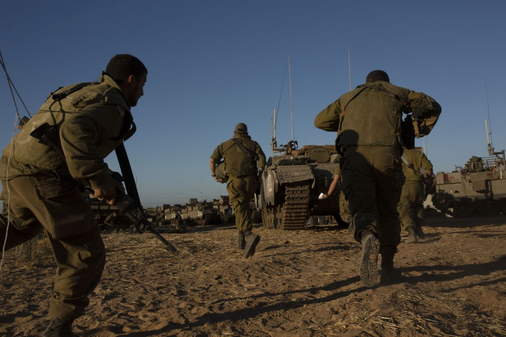 The Latest: Israeli Airstrikes Hit Buildings, Roads In Gaza