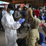 The Latest: Long Lines As Turkey Ramps Up Vaccinations