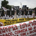 The Latest: Protests Decry Brazil Policies As Toll Tops 500k