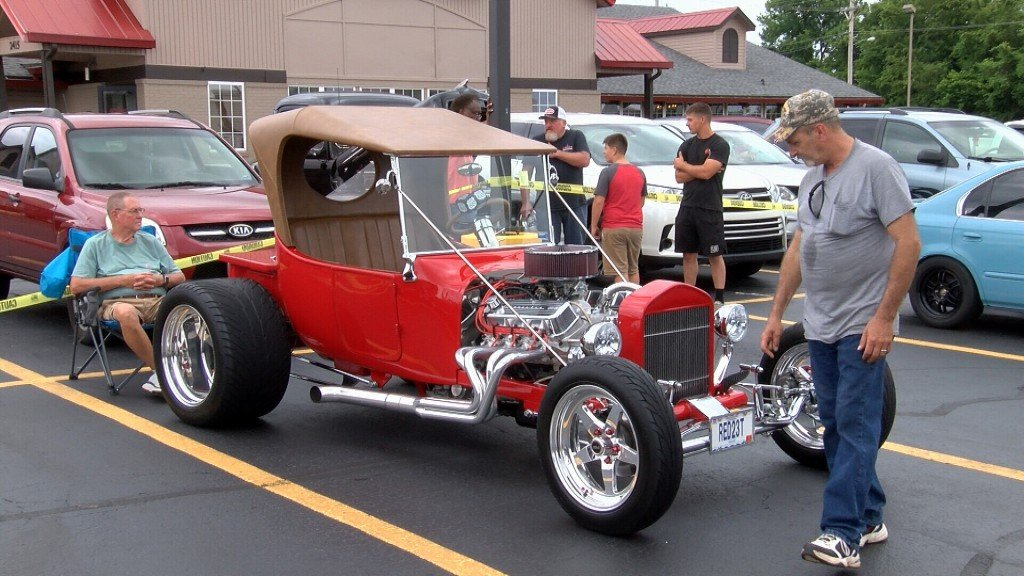 Folks In Joplin Check Out Classic Cars And Other Vehicles At A Car Show At Golden Corral