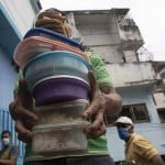 The Latest: Indian State Revises Death Count Up By 70%
