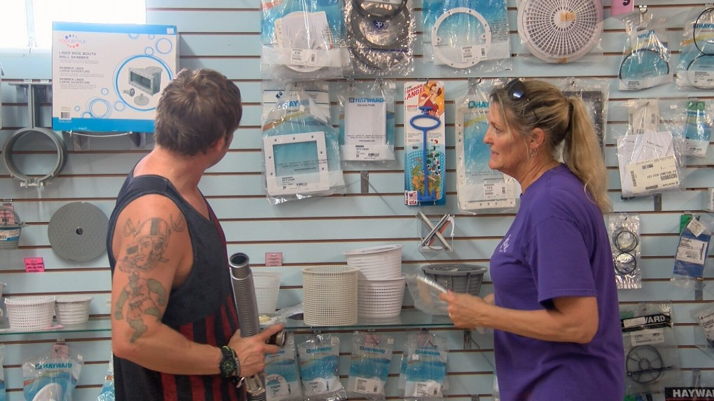 Terri Mcthompson Helps A Customer With Pool Supplies