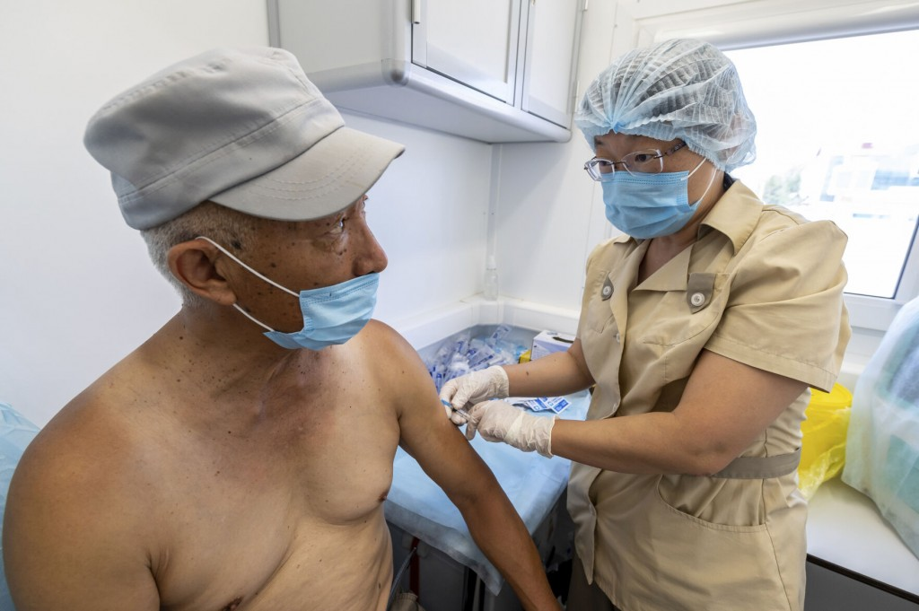 The Latest: Israel To Share Vaccine Doses With Palestinians