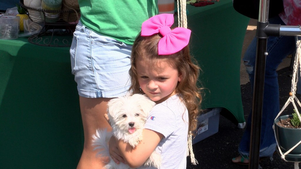 A Young Girl And Puppy Check Out The Neosho Farmers Market