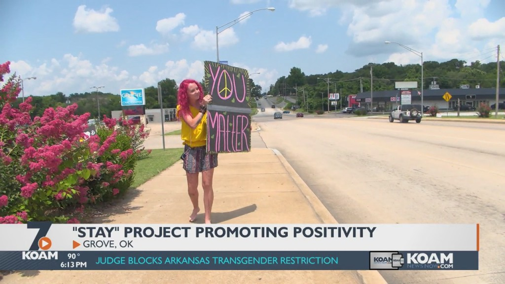 Woman Sets Up Positive Signs Throughout Her Community