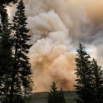 Western Wildfires Calm Down In Cool Weather, But Losses Grow