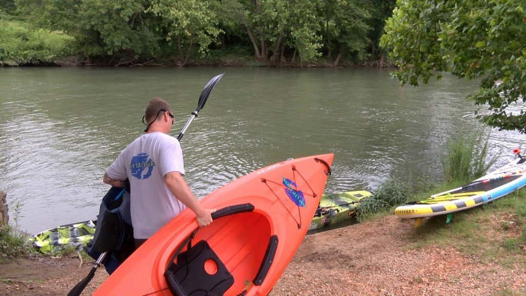 A 4 Stater Taking A Kayak Down To The Water