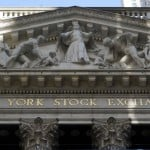 Us Indexes Wobble In Morning Trading, Hold Near Record Highs